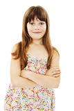 Portrait of a cute young girl standing with folded hands. Over white background royalty free stock images