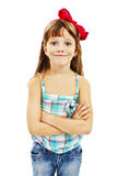 Portrait of a cute young girl standing with folded Stock Images