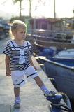 Portrait of cute young girl in yacht harbor Royalty Free Stock Photos