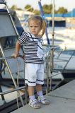 Portrait of cute young girl in yacht harbor Royalty Free Stock Images
