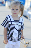 Portrait of cute young girl in yacht harbor Stock Photos