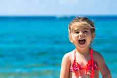 Portrait of cute young little girl on the beach stock image