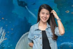 Portrait of cute young student in jacket jeans smile. On under water background Royalty Free Stock Images