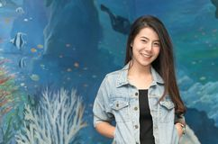 Portrait of cute young student in jacket jeans smile. On under water background Stock Photography