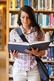 Portrait of a cute young student reading a book Stock Images