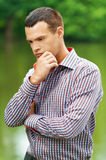 Portrait cute young thoughtful man Stock Photos