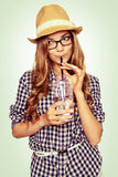 Portrait of a cute young woman with casual garb drinking water t Stock Photography