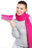 Portrait of cute young woman holding gift box in her hand Stock Photo