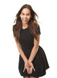 Portrait of a cute young woman laughing in black dress Royalty Free Stock Image