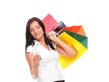 Portrait cute young woman mobile phone while holding shopping ba Stock Photography