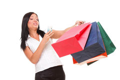 Portrait cute young woman mobile phone while holding shopping bags Stock Photos