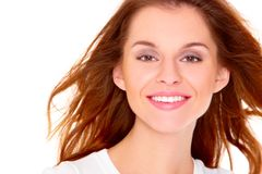 Portrait of cute young woman over white Royalty Free Stock Images