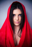 Portrait of cute young woman in red cloth Stock Photography