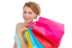 Portrait of cute young woman with shopping bags Stock Image