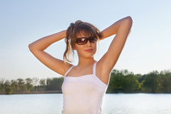 Portrait of a cute young woman in sunglasses Stock Photo