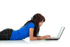 Portrait of a cute young woman using laptop Stock Image