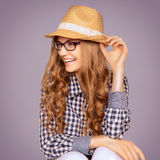 Portrait of a cute young woman wearing retro clothes and reading Stock Photography