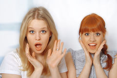 Portrait of cute young women surprised Royalty Free Stock Photo
