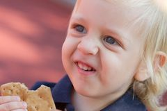 Cute blond boy with cookie Royalty Free Stock Images