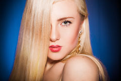 Portrait of cutie blonde with make up looking at camera Royalty Free Stock Image