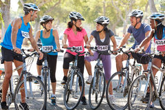 Portrait Of Cycling Club On Suburban Street royalty free stock image