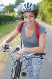 Portrait cyclist wearing helmet Stock Images