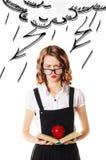 Portrait d'écolière malheureuse en verres sur un fond blanc Image libre de droits