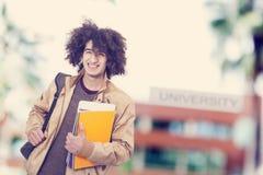 Portrait d'étudiant avec le sac à dos Photographie stock libre de droits