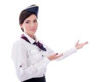 Portrait d'accueillir le steward (hôtesse de l'air) d'isolement sur le blanc Photos stock