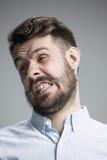 Portrait d'homme dégoûté Photos stock