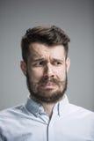 Portrait d'homme dégoûté Photographie stock