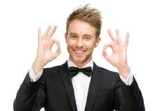 Portrait d'homme d'affaires faisant des gestes bien Photo stock