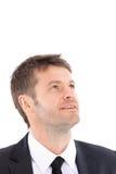 Portrait d'homme d'affaires semblant parti et de sourire Images stock