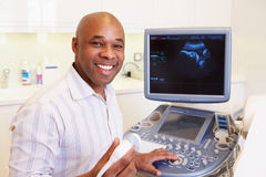 Portrait Of 4D Ultrasound Scanning Machine Operator And Doctor Stock Photography