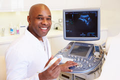 Portrait Of 4D Ultrasound Scanning Machine Operator And Doctor Stock Photos