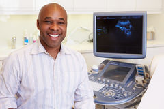 Portrait Of 4D Ultrasound Scanning Machine Operator And Doctor Royalty Free Stock Photos