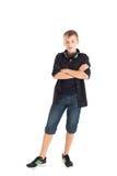 Portrait d'un adolescent mignon avec des écouteurs Photographie stock
