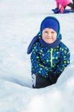 Portrait d'un bébé en hiver Photographie stock libre de droits