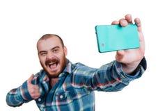 Portrait d'un brutal masculin rouge-barbu et presque chauve B d'isolement par blanc photographie stock libre de droits
