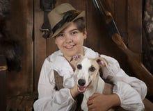Portrait d'un garçon avec un chien Images stock