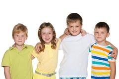 Portrait d'un groupe de quatre enfants de sourire Photographie stock