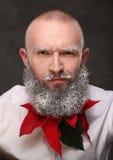 Portrait d'un homme avec la longue barbe peinte dans le blanc Images libres de droits