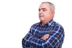 Portrait d'un homme de sourire avec des bras pliés Images libres de droits