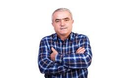 Portrait d'un homme de sourire avec des bras pliés Image stock