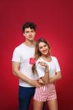 Portrait d'un homme et d'une femme dans le style de goupille- avec la sucrerie dedans Photographie stock