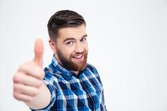 Portrait d'un homme occasionnel de sourire montrant le pouce  Images stock