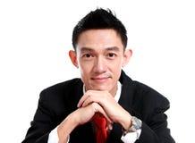 Portrait d'un jeune homme de sourire d'affaires, d'isolement sur le dos de blanc images libres de droits