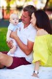 Portrait d'un père, d'une mère et d'un bébé Images stock