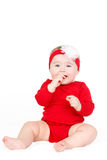 Portrait d'un rouge infantile adorable heureux de lin de bébé d'enfant reposant le sourire heureux sur un fond blanc Photos libres de droits