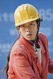 Portrait d'un travailleur de la construction féminin dans Pékin, Chine Photos stock